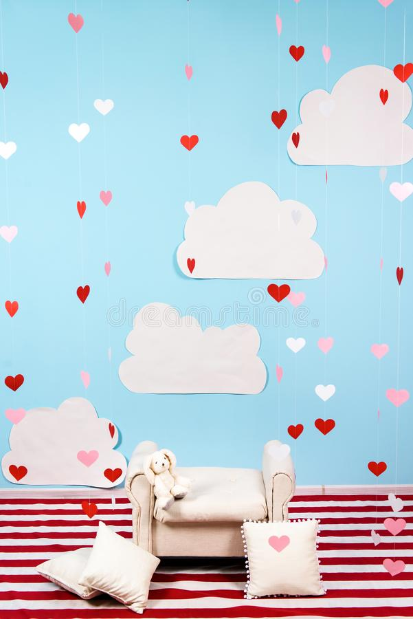 Minimalistic picture of a contrasted room with a rain of paper hearts royalty free stock photo