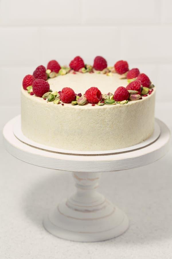 Minimalistic pistachio cake with raspberries. stock photo