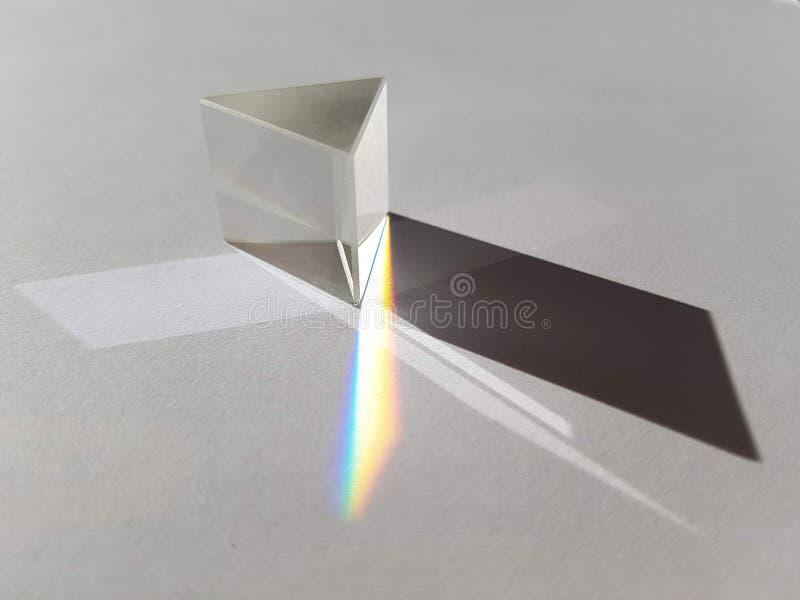 Minimalistic pyramid geometry2. Minimalistic glass pyramid geometry with sadow and rainbow stock photography