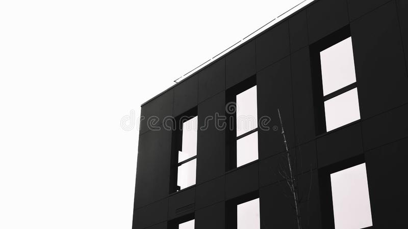 Minimalistic shot of a black architecture with white background stock illustration