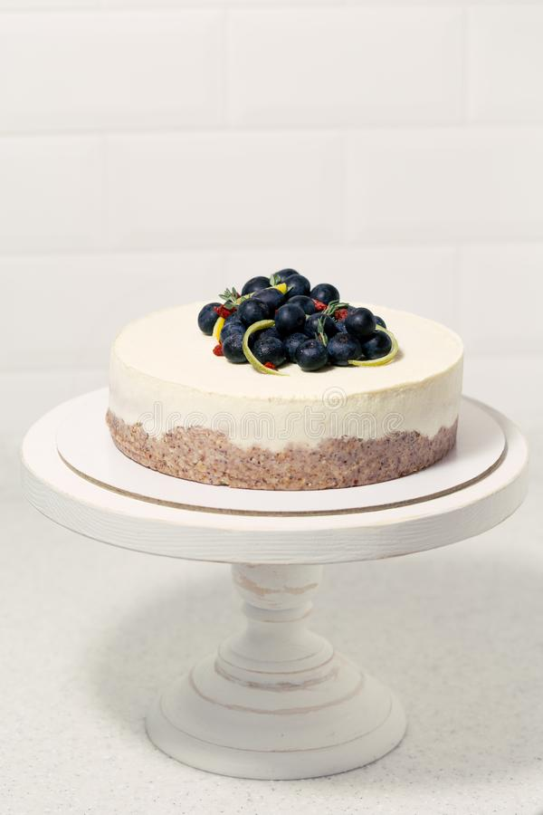 Minimalistic white cake with berries. royalty free stock photos