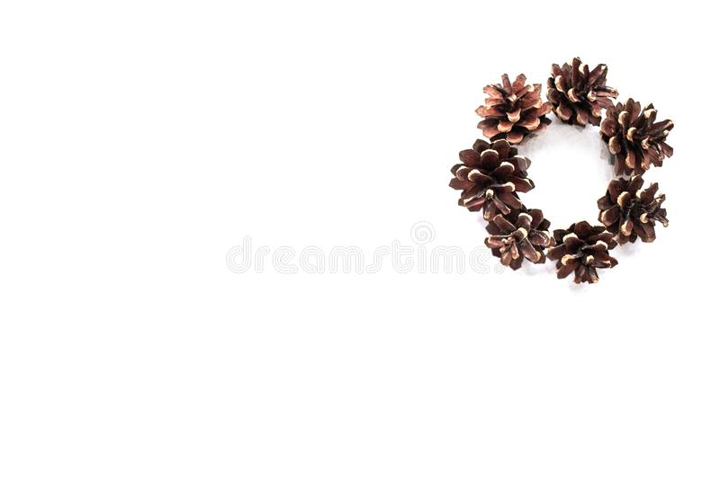 Minimalistic wreath of cones isolated on white background. place for text. concept of christmas and new year. top view royalty free stock images