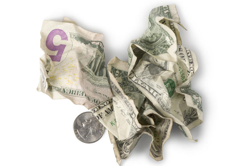 Minimum Wage - Crumpled Bills. Wrinkled and crumpled dollar bills and a quarter adding up to $7.25, the current (as of 2016) U.S. Federal Minimum wage royalty free stock images