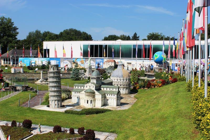 Minimundus miniature park at Klagenfurt, Austria. View of models and flags at Minimundus miniature park at Klagenfurt, Carinthia, Austria. In the front is the stock photo