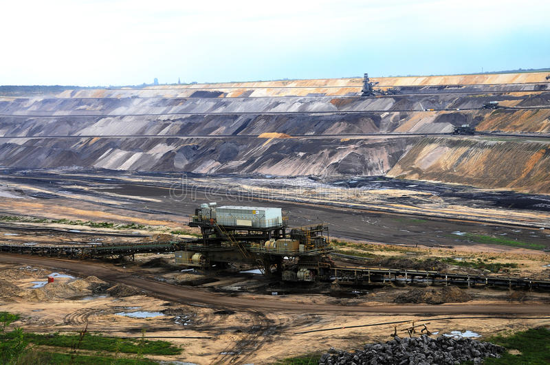 Mining. Brown coal open mining in Garzweiler, germany. A new field with coal is opened stock photo