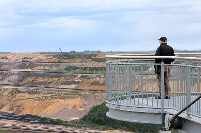 Mining. Brown coal open mining in Garzweiler, germany. A new field with coal is opened, A visitor on the obsevation deck royalty free stock photo