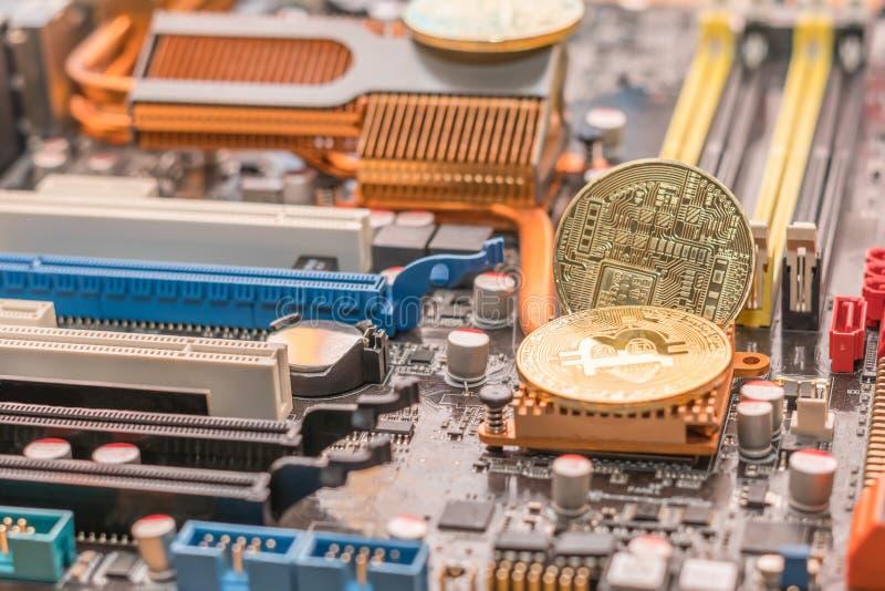 Mining btc crypto cash. Two bitcoin on radiator of desktop computer mainboard stock image