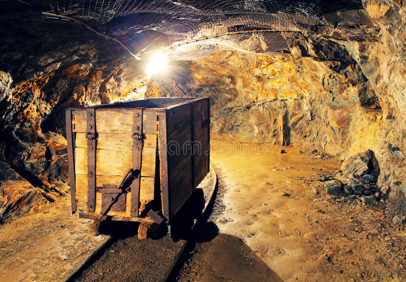 Mining cart in silver, gold, copper mine.  stock photography