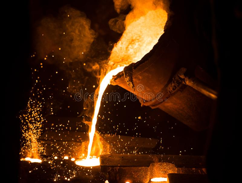 Mining casting work metal casting. Mining casting work in fabric royalty free stock photos