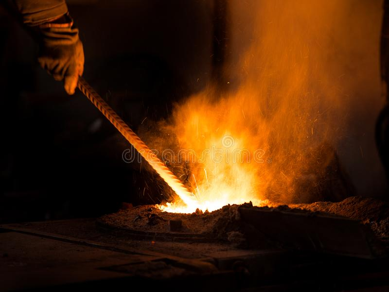 Mining casting work metal casting. Mining casting work in fabric stock photo