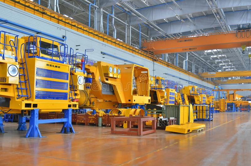 Workshop assembly of large dump trucks. Mining dump truck manufacturing plant. Workshop assembly of large dump trucks stock photos