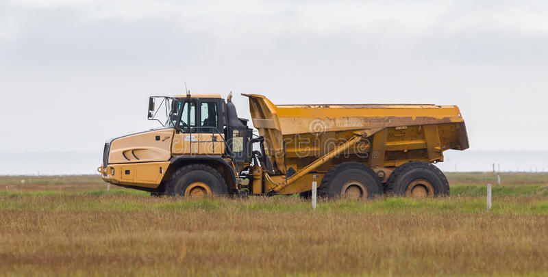 Mining dump truck. Working in a field in Iceland royalty free stock images