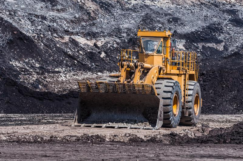 Mining Equipment or Mining Machinery, Bulldozer from open-pit or open-cast mine as the Coal Production. Mining Equipment or Mining Machinery, Bulldozer, wheel stock photos