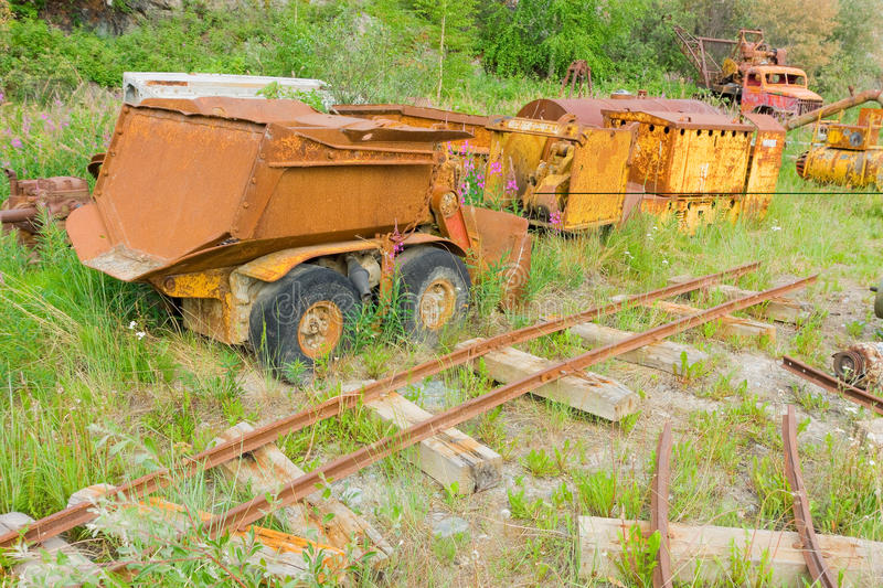 Mining equipment at an outdoor museum in yellowknife. Old, retired vehicles rusting at a gold-mining display in the northwest territories stock image