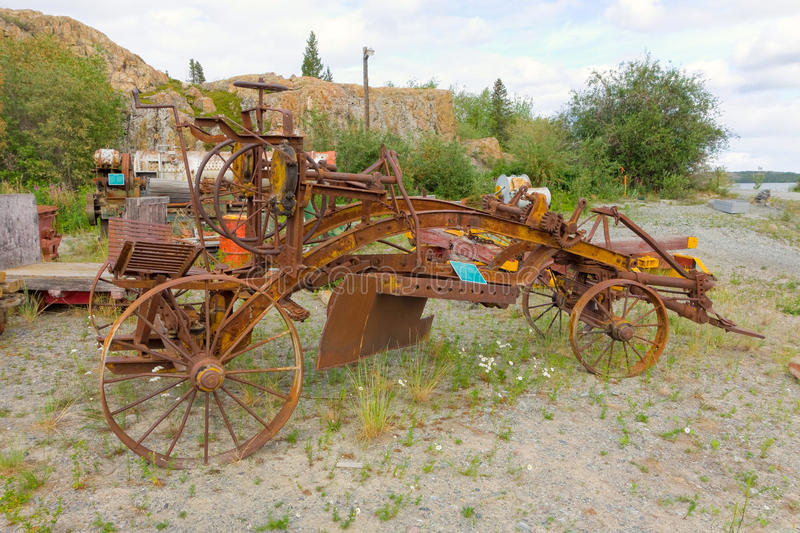 Mining equipment at an outdoor museum in yellowknife. Old, retired vehicles rusting at a gold-mining display in the northwest territories royalty free stock image