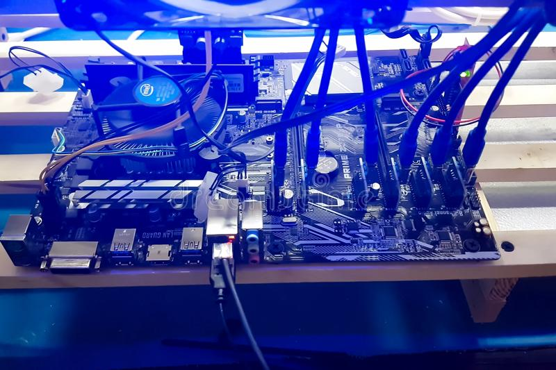 Mining farm of several video cards. The farm is mining at home. royalty free stock images