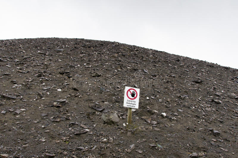 Mining hill. And danger sign stock image