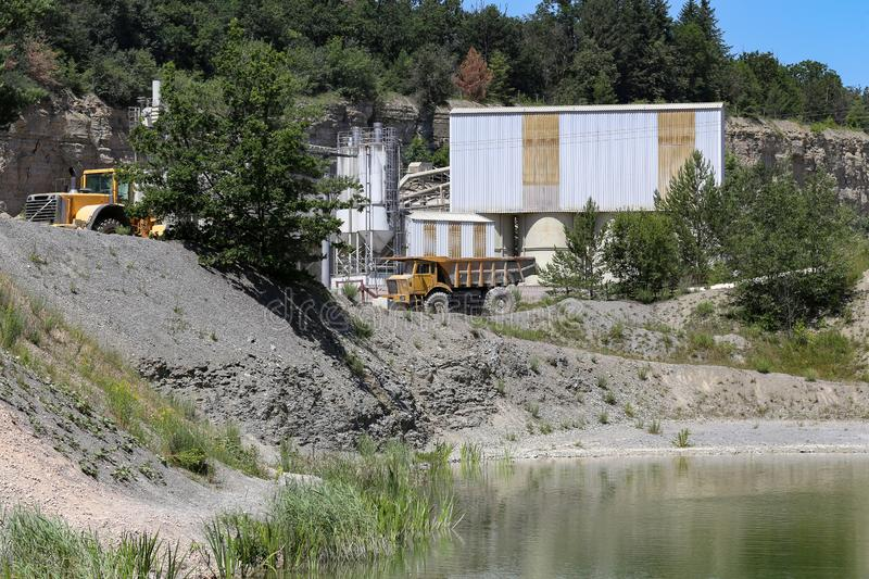 Mining sand and gravel in an industrial quarry royalty free stock photography