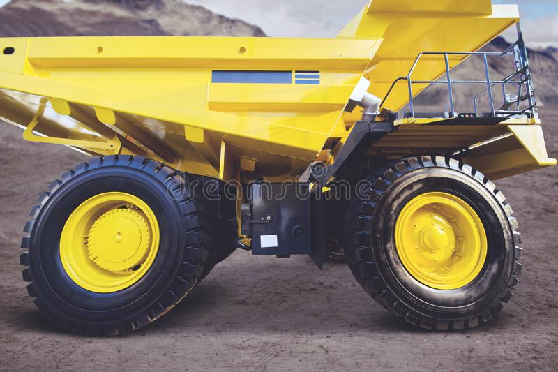 Mining truck parked in the construction site stock images