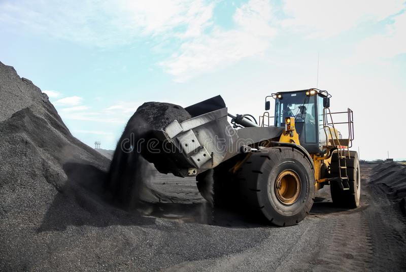 Mining wheel loader for transporting Manganese for processing stock photos