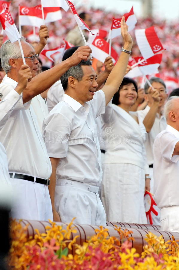 Ministers waving Singapore flags during NDP 2009