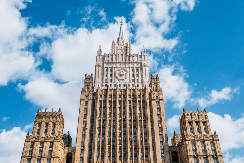 Ministry of Foreign Affairs of Russia style of Stalinist architecture against a blue sky with white clouds. stock photos