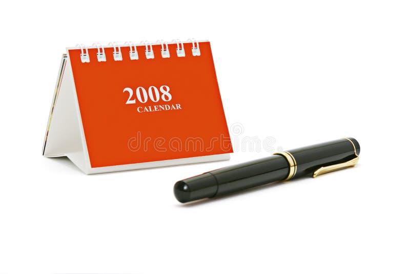 Minitischplattenkalender und Feder stockfotos
