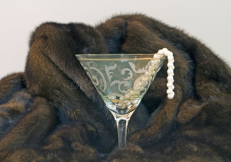 Mink cocktail strand of pearls stock photo