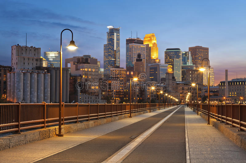 Minneapolis. Image of Minneapolis skyline taken from Stone Arch Bridge at sunset royalty free stock images