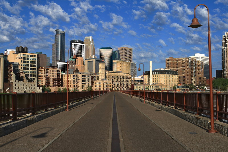 Minneapolis. Early morning view of downtown Minneapolis across the Stonearch Bridge stock images