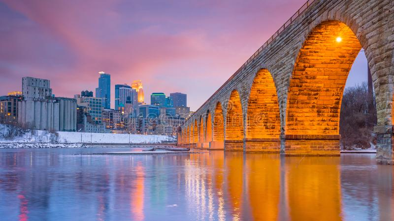 Minneapolis downtown skyline in Minnesota, USA. At sunset stock photos