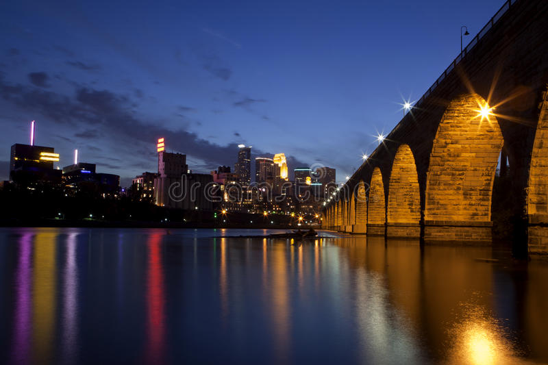 Minneapolis, Minnesota. The famous Stone Arch Bridge at dusk with reflections in the Mississippi river in Minneapolis, Minnesota royalty free stock image