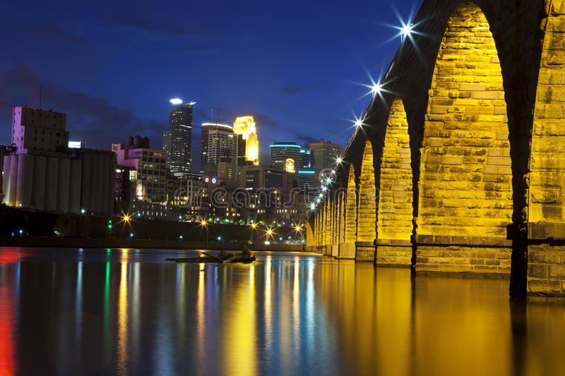 Minneapolis, Minnesota. The famous Stone Arch Bridge at dusk with reflections in the Mississippi river in Minneapolis, Minnesota royalty free stock photography
