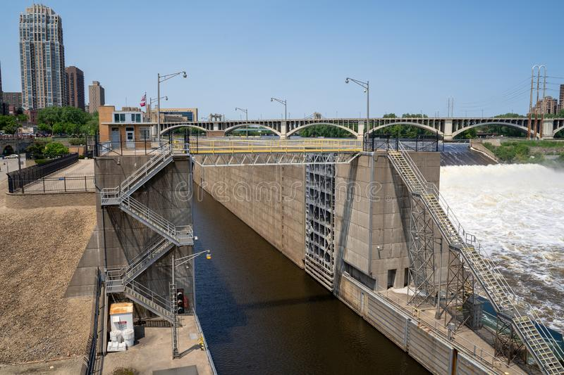Minneapolis, Minnesota - June 1, 2019: View of the Upper St. Anthony Falls Lock and Dam along the Mississippi River in downtown royalty free stock image