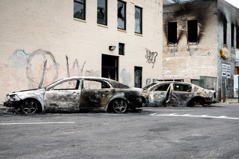 Burned down damaged cars after looting and minneapolis riots for George Floyd Black Lives Matter protests. Minneapolis, Minnesota / USA - June 2 2020: Burned royalty free stock image