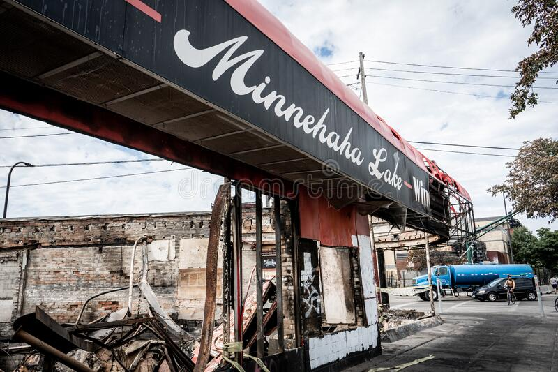 Burned local business now collapsed wreckage after looting and Minneapolis riots for George Floyd in Black Lives Matter protests. Minneapolis, Minnesota / USA royalty free stock image