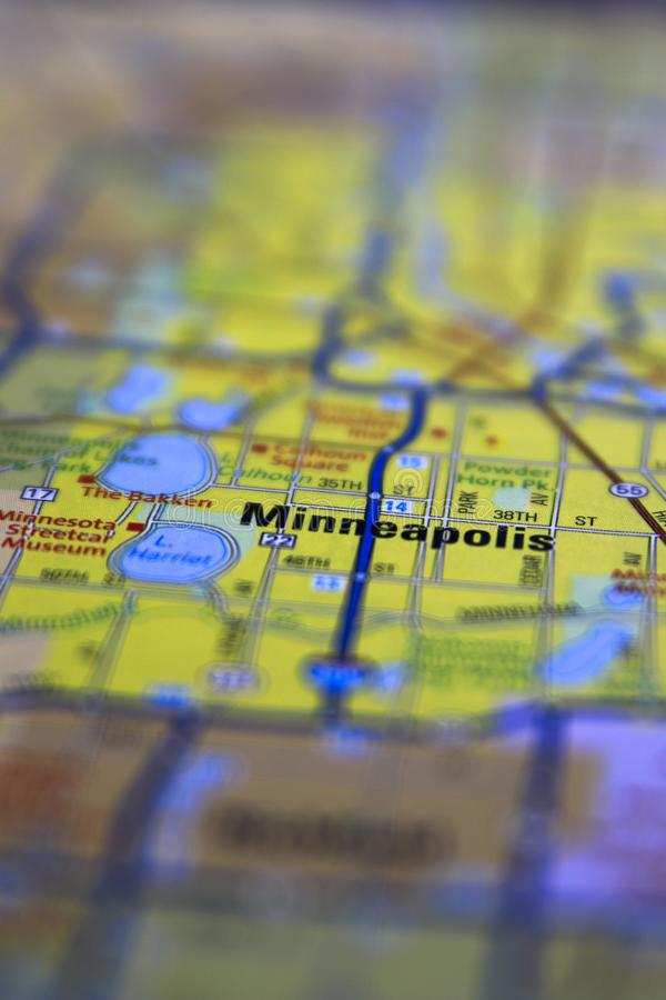 Minneapolis MN, centered on a paper roadmap with limited focus. City, travel, minnesota, geography, atlas, usa, cartography, macro, midwest, trip, america royalty free stock photos