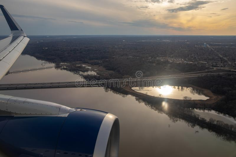 Minneapolis, MN / USA - April 3, 2019: Aerial view of Mississippi River while flying over Minneapolis at Sunset royalty free stock photo