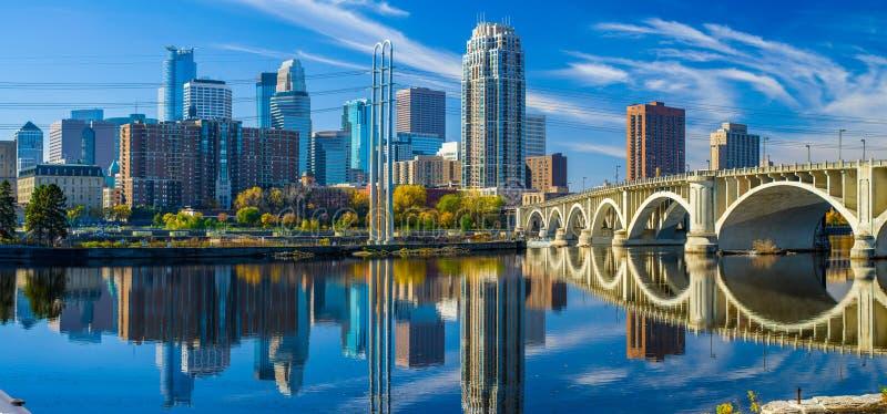 Minneapolis skyline, 3rd avenue bridge, autumn. The 3rd avenue bridge crosses over the mississippi river toward the minneapolis skyline, autumn stock photos
