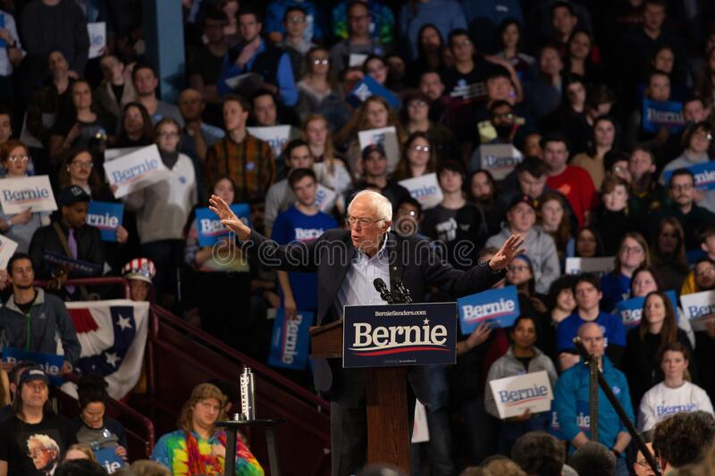 Scene from the heated rally of Bernie Sanders with the crowd holding banners actively cheering. MINNEAPOLIS, UNITED STATES - Nov 03, 2019: A scene from the stock photos
