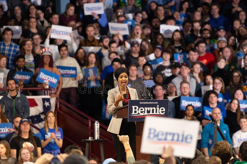 Scene from the heated rally of Bernie Sanders with the crowd holding banners actively cheering. MINNEAPOLIS, UNITED STATES - Nov 03, 2019: A scene from the royalty free stock image