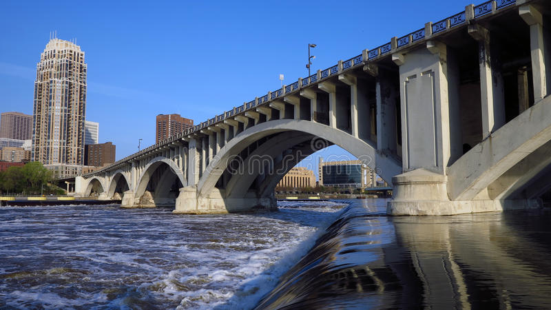 Minneapolis Urban City 5. Minneapolis downtown with its many modern towers and the Central Avenue bridge, over the Mississippi River. Photo taken at dawn from royalty free stock image