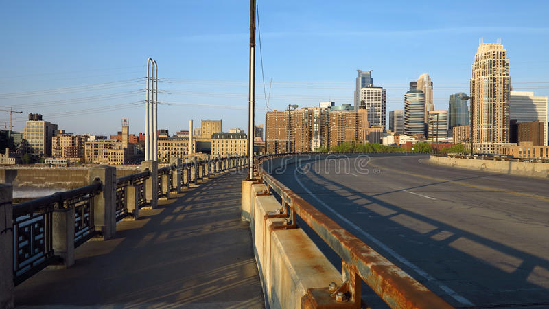 Minneapolis Urban City 2. Downtown Minneapolis with its many modern towers. Photo taken at sunrise from the bridge of Central Avenue, above the Mississippi River royalty free stock image