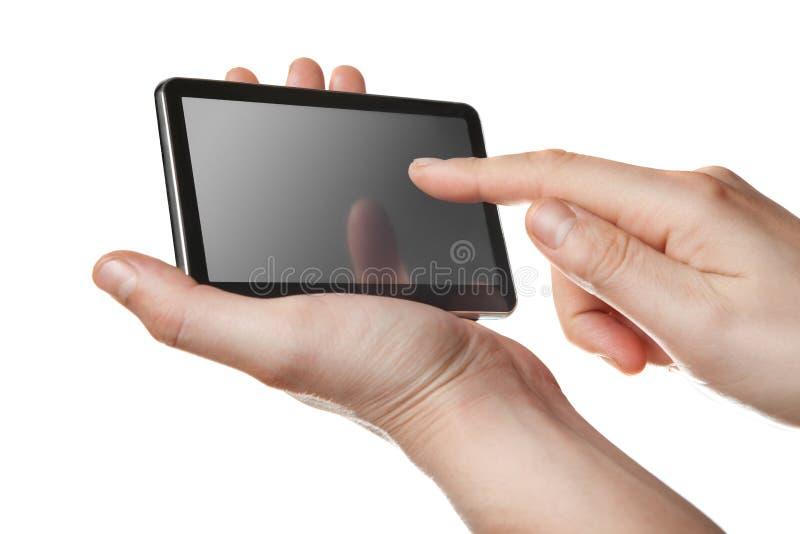 MinnestavlaPC med pekskärmen i isolerade händer arkivfoton