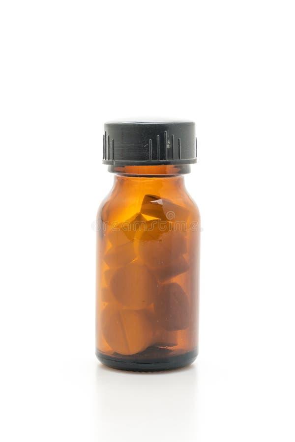 Minnestavlapiller, droger, apotek, medicin eller läkarundersökning på vit bac arkivfoto