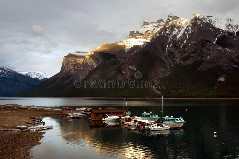 Minnewanka lake. Boats on Minnewanka lake, Banff national park royalty free stock photography