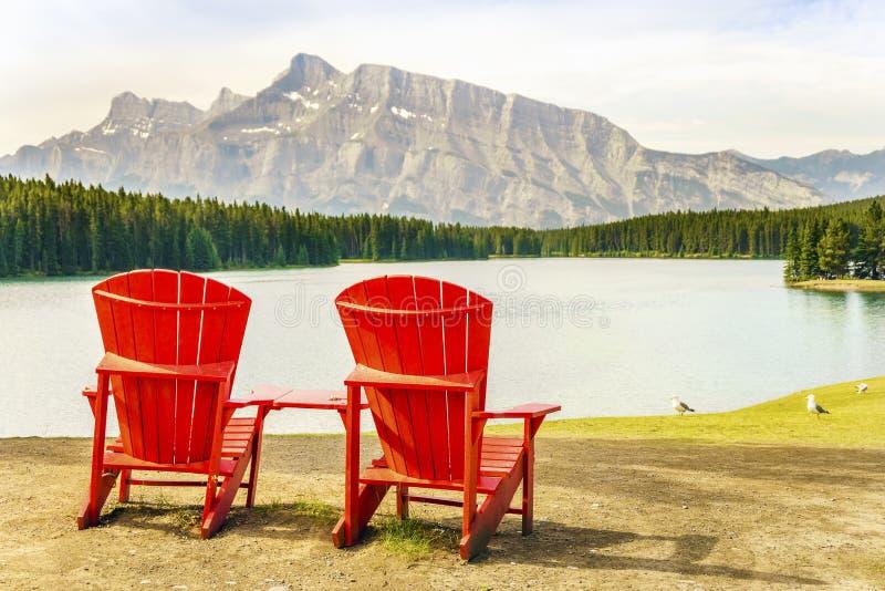 Minnewanka Lake in Banff National Park, Canada. Minnewanka Lake and two red chairs in Banff National Park, Alberta, Canada royalty free stock photo