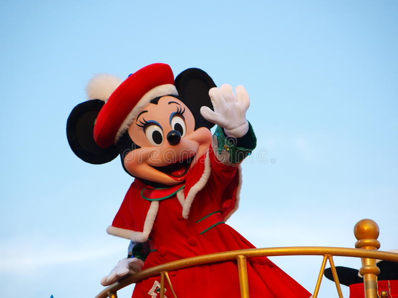 Minnie Mouse in Tokyo-Disneyland, Japan. Tokyo, Japan - December 14, 2012: Minnie Mouse in the red coat waving her hand in daytime Parade at Tokyo-Disneyland royalty free stock image