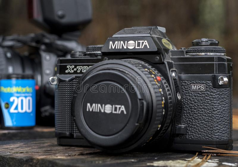 Minolta 35mm single-lens reflex camera. Vintage 35mm SLR camera with roll of film. Minolta X-700 purchased in the 1980s. Minolta was a Japanese manufacturer of stock images
