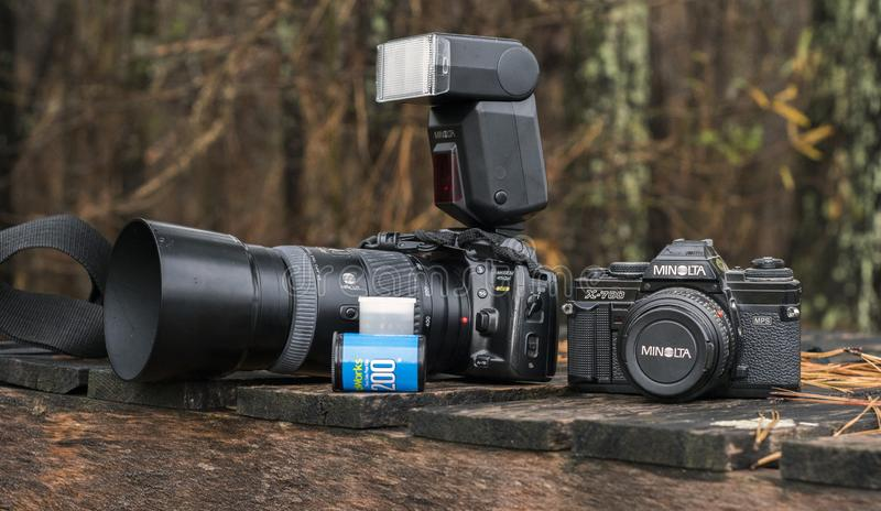 Minolta 35mm single-lens reflex camera. Vintage 35mm SLR cameras with roll of film. Minolta X-700 purchased in the 1980s. Minolta Maxxum 450si purchased in 1990s stock photo